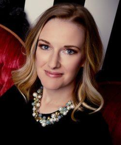 A headshot of soprano Jeni Houser