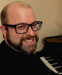 Headshot of Scott Gendel at a piano